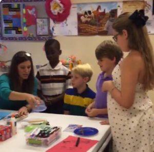 Natalie teaching children